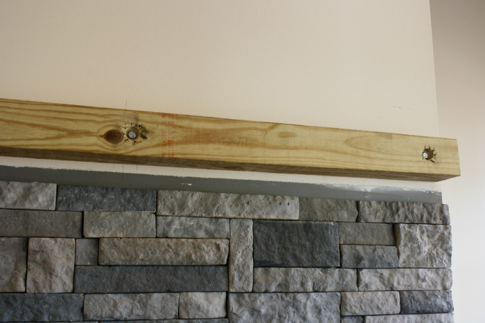 Instructions for how to build a floating fireplace mantle using stock lumber from your local hardware store.