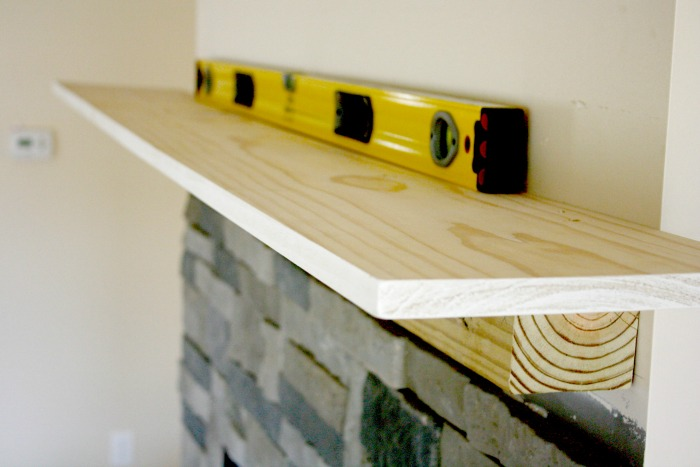 DIY Fireplace mantle with 6 boards