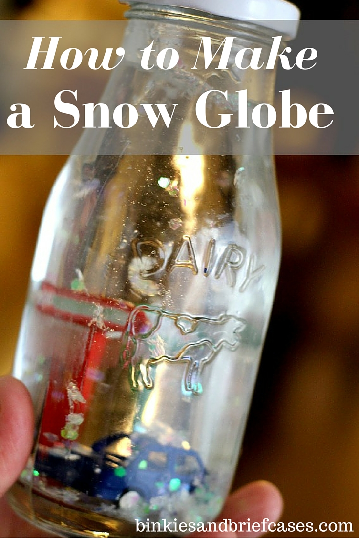 How to make a homemade snow globe in a milk bottle. What a cute winter craft! Love the pencil trick.