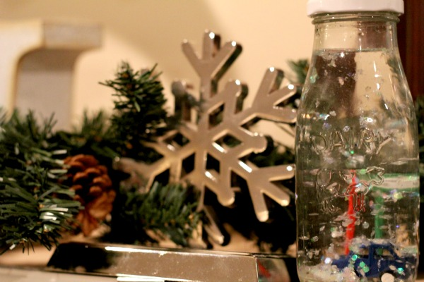 homemade snowglobe on mantle